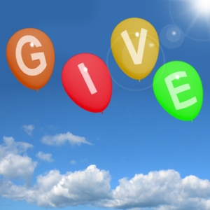 Give Word On Balloons Showing Charity Donations And Generous Assistance